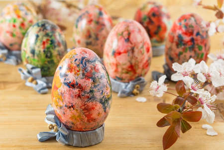 holders: Painted Easter eggs in custom made egg holders Stock Photo