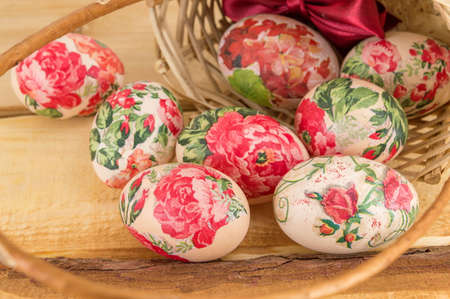 falling out: Decorated Easter eggs falling out of vintage wicker basket Stock Photo