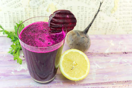 Beetroot juice in a glass decorated with fresh beetroot Reklamní fotografie