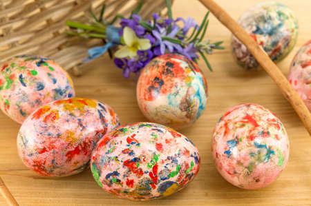 falling out: Painted Easter eggs falling out of a wooden basket Stock Photo