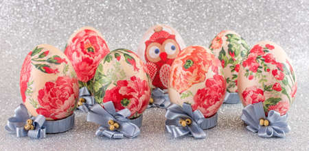 decoupage: Colorful homemade decoupage decorated Easter eggs against shiny silver background Stock Photo