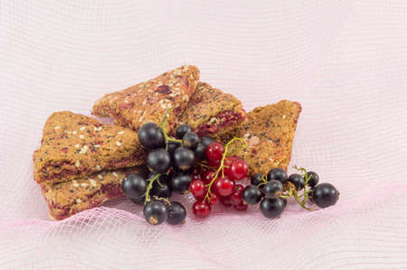 Bunch of integral fruit biscuits with fresh fruit