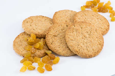 integral: Integral cookies with yellow raisins on white