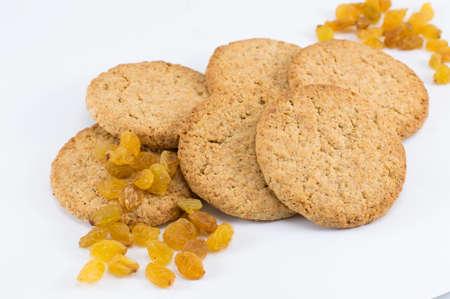 Integral cookies with yellow raisins on white