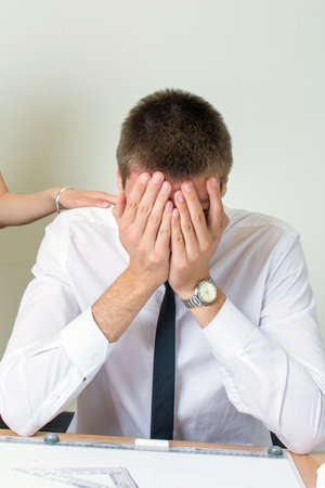 consoling: Consoling a young businessman under stress at work Stock Photo