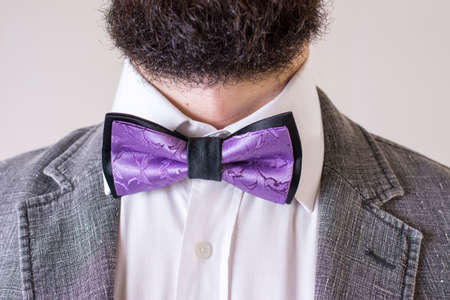 Bearded man in a suit with a bow tie Imagens