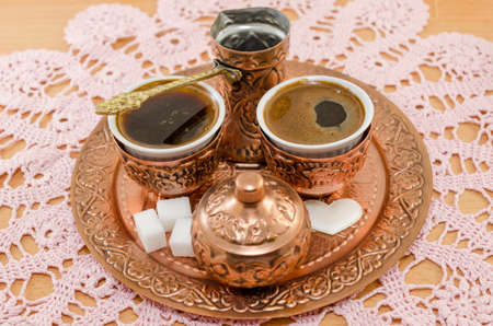 turkish coffee: Turkish coffee served in traditional copper pottery Stock Photo