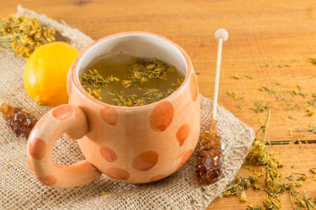 yarrow: St Johns wort tea and surrounded by dried kantarion plants