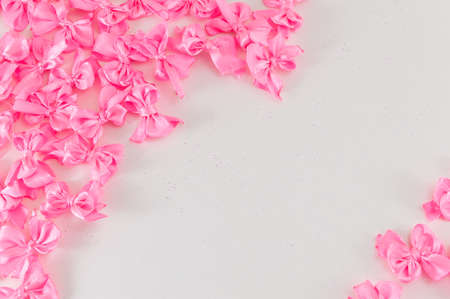 scattered on white background: pink ribbons with copy space on white Stock Photo