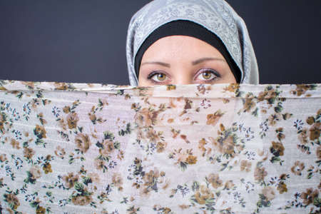 religious clothing: Beautiful muslim woman with colorful scarf