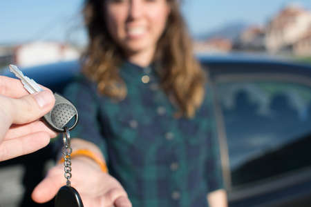 Let you be the driver. Young female being handed the car keys Stock Photo