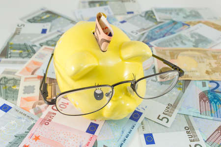 smart investing: Piggy bank on top of euro bills Stock Photo