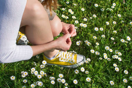 dasiy: Woman picking daisies in a daisy field