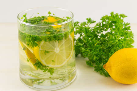 Water with parsley and lemon. Diet beverage Reklamní fotografie