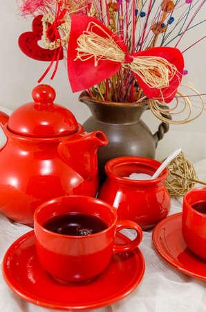 tea set: red porcelain tea set on white