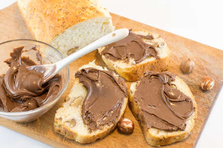 Chocolate cream on a homemade walnut bread slices Imagens