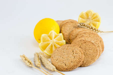integral: Integral biscuits decorated with lemon on white background Stock Photo