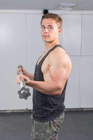 warming up: Man warming up his biceps at the gym