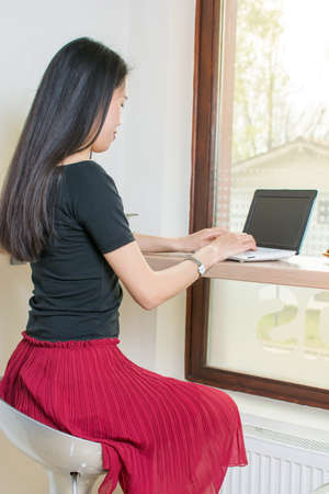 lap top: Young asian woman by lap top