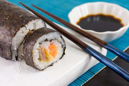 served: Sushi rolls served with wooden chopsticks Stock Photo