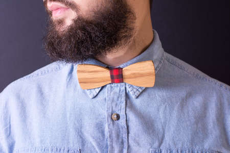 Bearded man with a wooden bow tie close up Reklamní fotografie