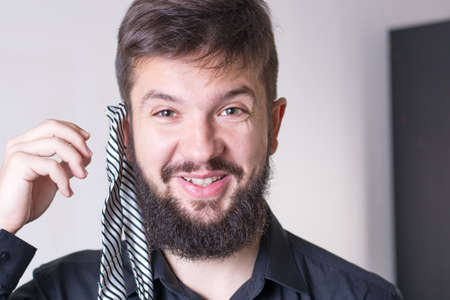 funny bearded man: Man trying out a striped tie