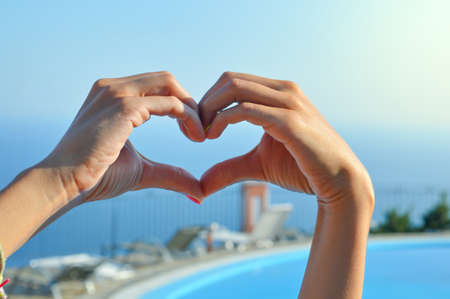 romantic beach: Love for summer vacation. Hands making heart shape Stock Photo