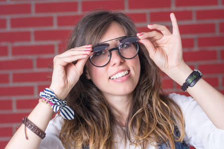 preety: Woman trying out a pair of double eyesight glasses