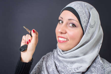 religious clothing: Beautiful muslim woman holding a car keys