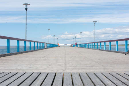 fense: PALANGA LITHUANIA - JUNE 13: View at the Palanga wooden dock. Palanga is the most popular summer resort in Lithuania Editorial