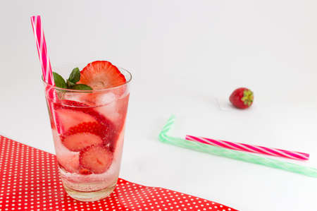 non alcoholic beverage: Cold strawberry juice with ice cubes for a hot summer day Stock Photo