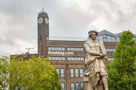 headquaters: AMSTERDAM - SEPTEMBER 17, 2015: Rembrant monument in front of booking.com headquaters in famous Rembrant park in Amsterdam Editorial