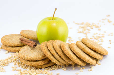 Integral biscuits with apple and wheat seeds on white background Imagens