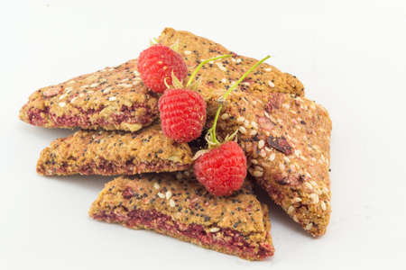 Integral biscuits with fresh red raspberry fruit Imagens