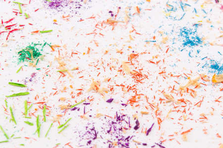 sharpening: Blank white paper covered in colored pencils sharpening leftovers