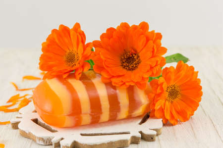 glycerin soap: marigold soap with a fresh flower bouquet. Natural cosmetics product Stock Photo