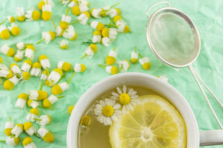 chamomile flower: Chamomile tea with lemon slices and flowers