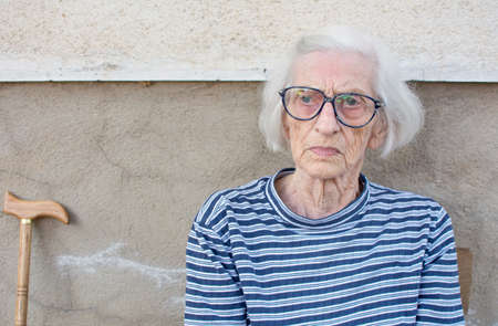Ninety years old grandma portrait while sitting outdoors