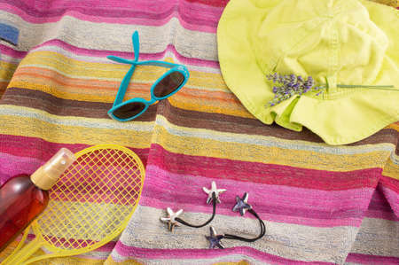 Summer accessories on beach towel top view Reklamní fotografie