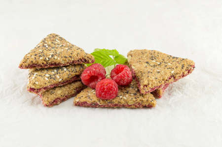 integral: Integral triangle shaped biscuits with fresh raspberry fruit Stock Photo