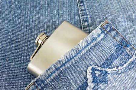 hip flask: Hip flask in denim blue jeans pocket