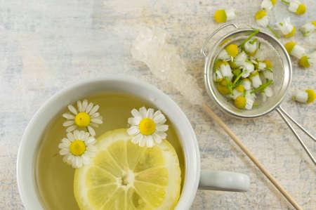 chamomile tea: Chamomile tea with lemon slices and flowers