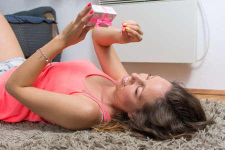 hapy: Girl lying on the carpet with a present box