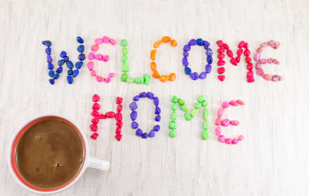welcome home: Welcome home note and a cup of coffee