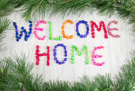 welcome home: Welcome home note written with small colorful rocks Stock Photo