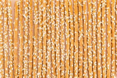 gressins: Bunch of salty breadsticks snack background pattern Banque d'images