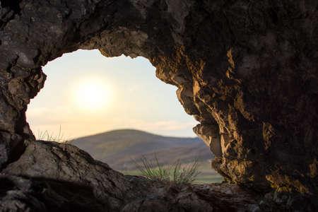 natual: looking thru a natual cave opening
