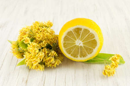 Linden Tea with fresh flowers and lemon served Stock Photo