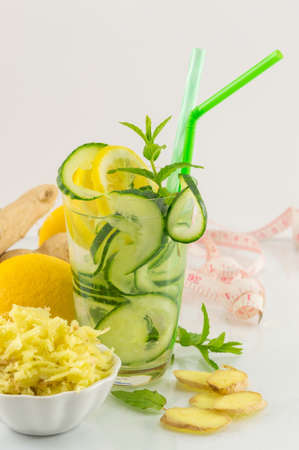 ginger root: Diet drink with ginger root, lemon and parsley Stock Photo