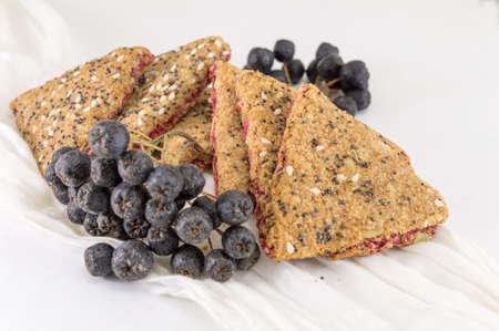Sweet integral cookies with aronia fruit on a table